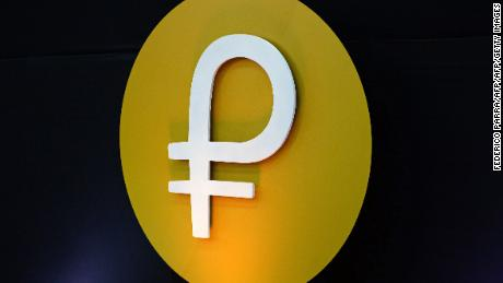 "View of the logo of the ""Petro"" during a press conference to launch to the market a new oil-backed cryptocurrency called ""Petro"", at the Miraflores Presidential Palace in Caracas, on February 20, 2018.  Venezuela formally launched its new oil-backed cryptocurrency on Tuesday in an unconventional bid to haul itself out of a deepening economic crisis. The leftist Caracas government put 38.4 million units of the world's first state-backed digital currency, the Petro, on private pre-sale from the early hours. A total of 100 million Petros will go on sale, with an initial value set at $60, based on the price of a barrel of Venezuelan crude in mid-January.  / AFP PHOTO / FEDERICO PARRAFEDERICO PARRA/AFP/Getty Images"