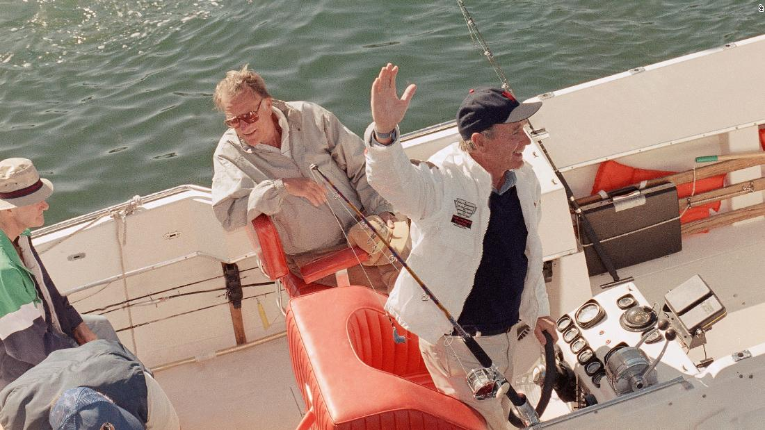 Graham takes a boat ride with US President George H.W, Bush near Bush's summer home in Kennebunkport, Maine, in 1989.