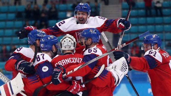 Team Czech Republic celebrates its win after an overtime shootout against Team USA.
