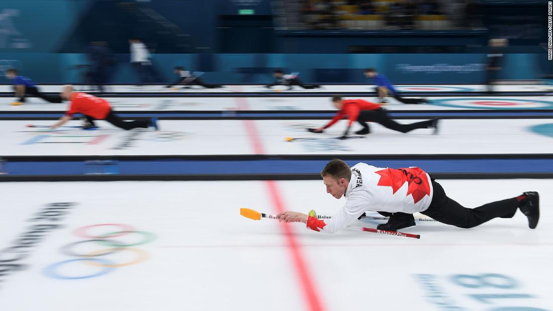 Canada's Marc Kennedy practices before a curling match against Denmark.