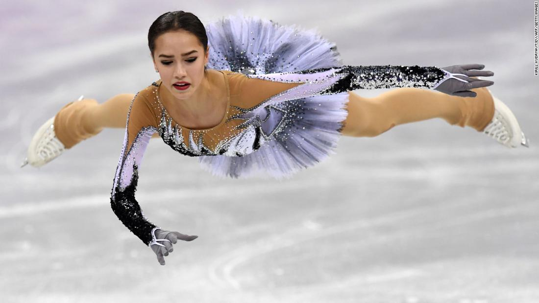 "Figure skater Alina Zagitova glides through the air during her short program. <a href=""https://www.cnn.com/2018/02/21/sport/olympics-ice-skating-zagitova-medvedeva-intl/index.html"" target=""_blank"">The 15-year-old set a new world record,</a> breaking the one set only minutes before by fellow Russian Evgenia Medvedeva."