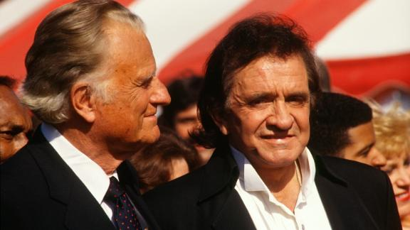 Graham stands next to singer Johnny Cash in New York's Central Park.