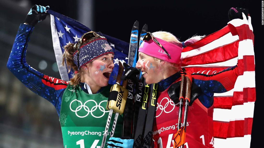 Cross-country skiers Jessica Diggins, left, and Kikkan Randall celebrate after winning gold in the team sprint event. They are the first American women to win an Olympic medal in the sport.