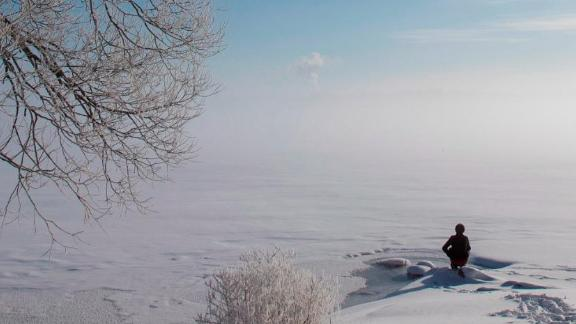 Ontario, Canada: On a February morning, mist rises over the frozen Cataraqui River in Kingston, Ontario.