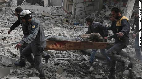Syrian rescue workers carry an injured civilian on a stretcher from an area hit by a reported regime airstrike in the rebel-held town of Saqba, in Eastern Ghouta, on Tuesday.