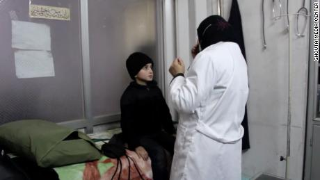 Dr. Wassem Mohammad examines a young boy in a medical facility in Eastern Ghouta. The boy needs specialized medicine not available to those under the siege.