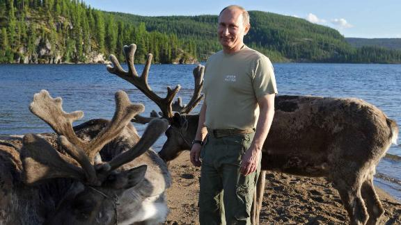 Russian President Vladimir Putin with deer in southern Siberia during a vacation in 2013.