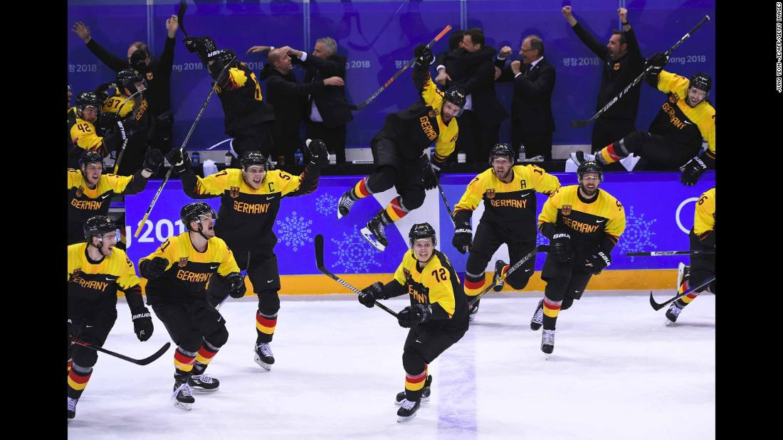 German hockey players celebrate after their overtime victory over Sweden in the quarterfinals.