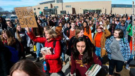 Students at Mayo High School stage a walkout against gun violence for 17 minutes during the school day Wednesday, Feb. 21, 2018, in Rochester, Minn. The 17 minutes were in memory of the 17 victims in the Marjory Stoneman Douglas High School shooting in Parkland, Fla., on Feb. 14.