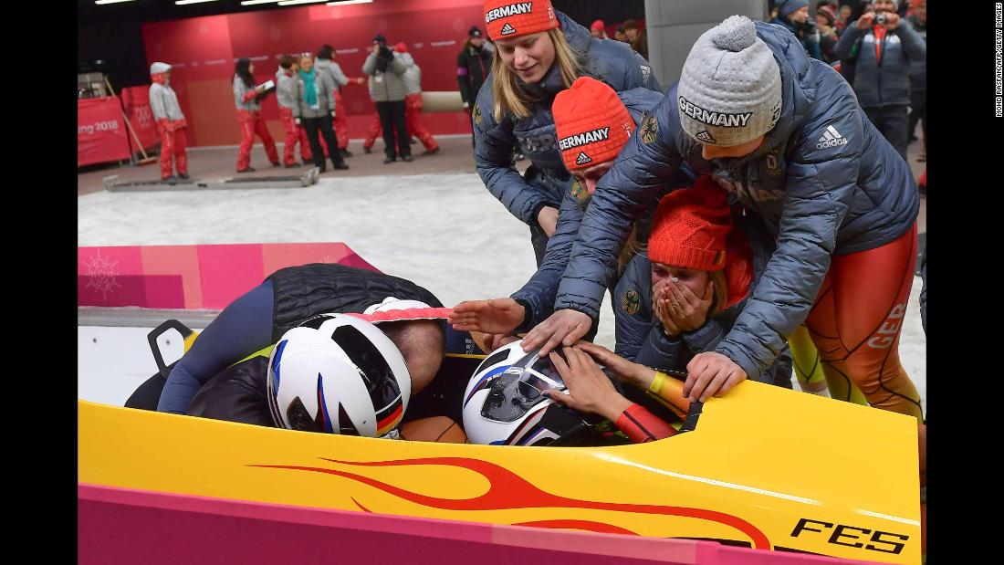 German bobsledders Mariama Jamanka and Lisa Buckwitz celebrate after winning gold.
