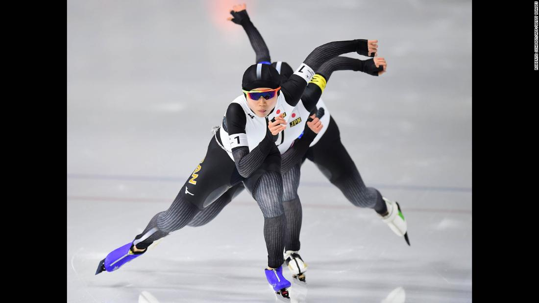 Japanese speedskaters, led by Miho Takagi in the foreground, compete in the team pursuit final. They won gold with an Olympic-record time.