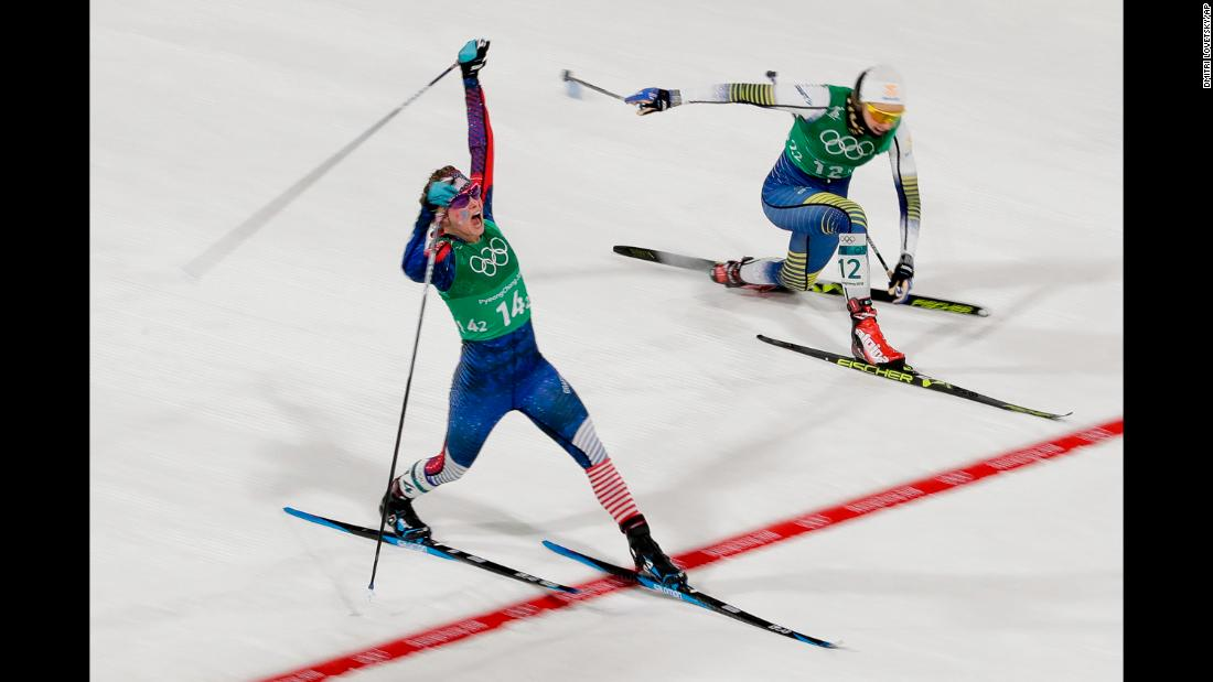 Diggins stretches across the finish line, just ahead of Sweden's Stina Nilsson.