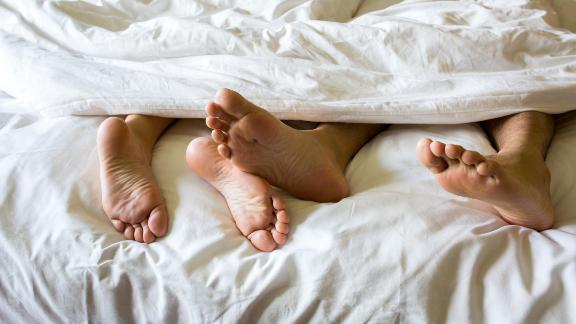 Foot man and girl be tired on the bed, couple bed story; Shutterstock ID 642965416; Job: -
