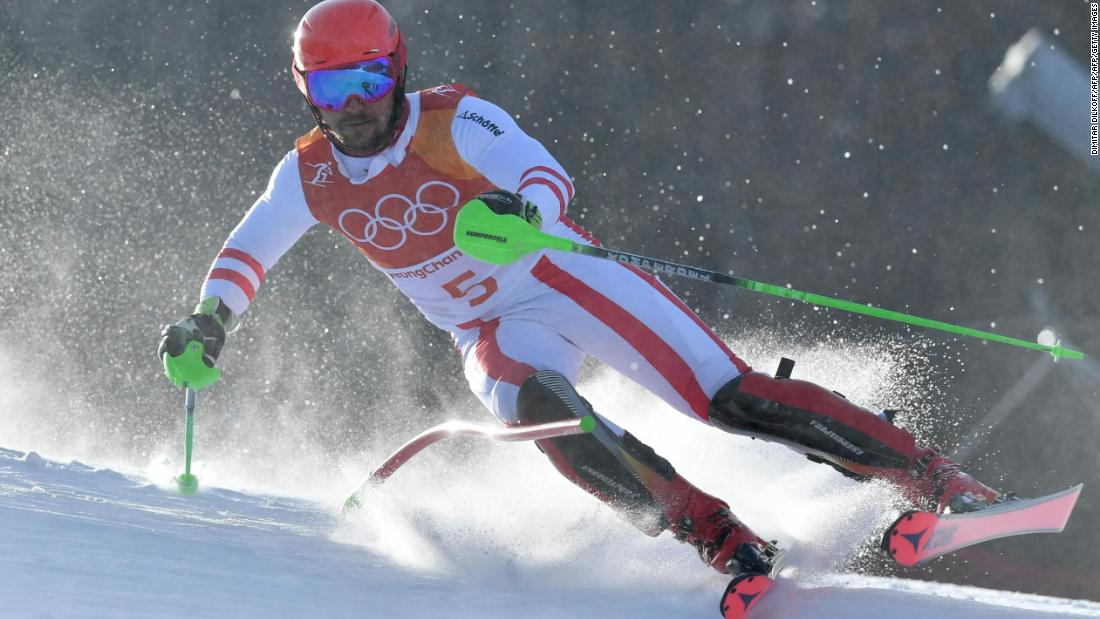 Austrian skier Marcel Hirscher, the favorite in the men's slalom, crashed out in his first run.