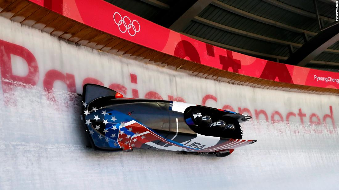 Nick Cunningham drives a US bobsled during a four-man training run.