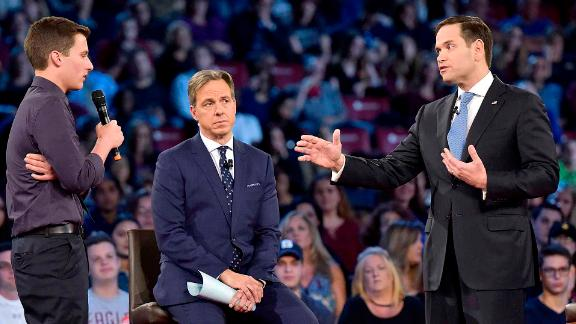Marjory Stoneman Douglas student Cameron Kasky asks Sen. Marco Rubio (R-Fla.), right, if he will continue to accept money from the NRA during a CNN town hall meeting on Wednesday, Feb. 21, 2018, at the BB&T Center, in Sunrise, Fla. (Michael Laughlin/Sun Sentinel/TNS via Getty Images)