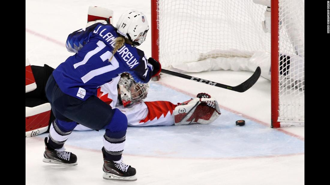 Jocelyne Lamoureux scores the deciding goal of the shootout, slipping the puck past Canada's Shannon Szabados.
