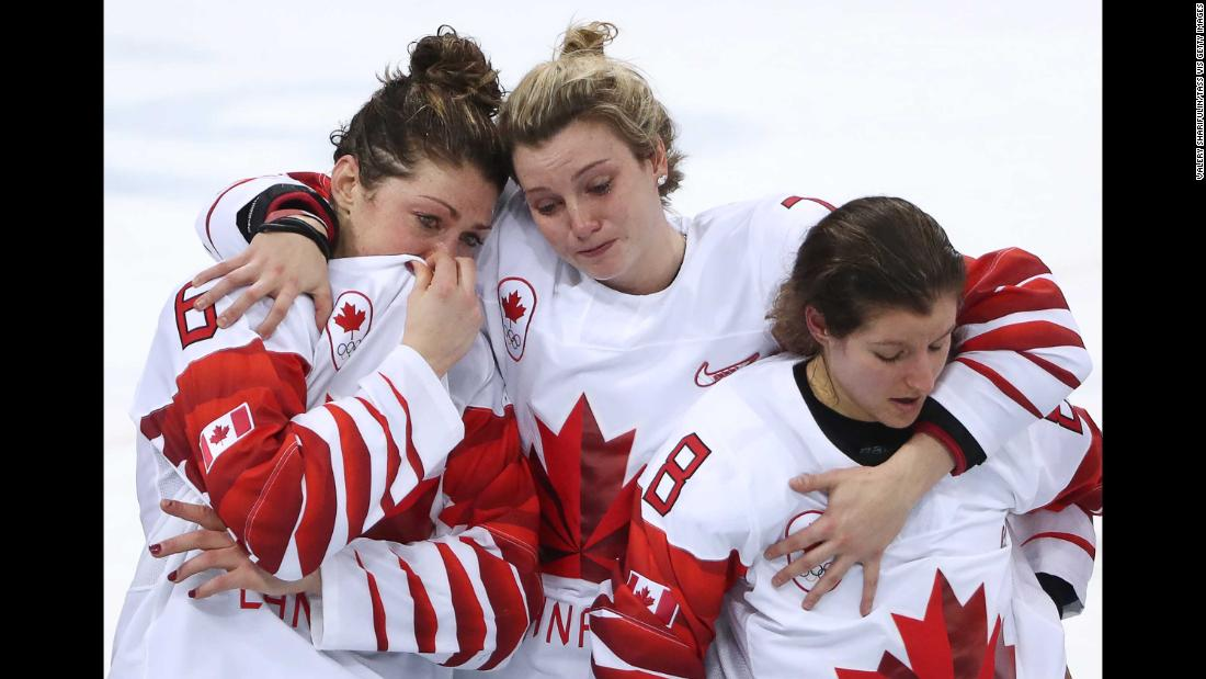The Canadian players console themselves after their loss.