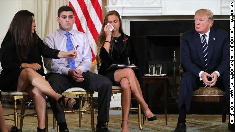WASHINGTON, DC - FEBRUARY 21:  (AFP OUT) U.S. President Donald Trump (R)  hosts a listening session with Marjory Stoneman Douglas High School shooting survivors Julie Cordover (2nd R) and  Jonathan Blank and his mother Melissa Blank and others in the State Dining Room at the White House February 21, 2018 in Washington, DC. Trump is hosted the session in the wake of last week's mass shooting at the high school in Parkland, Florida, that left 17 students and teachers dead.  (Photo by Chip Somodevilla/Getty Images)