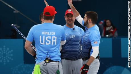 GANGNEUNG, SOUTH KOREA - FEBRUARY 22:  Matt Hamilton, George Tyler, John Shuster, John Landsteiner of USA celebrate victory in the Curling Men's Semi-final against Canada on day thirteen of the PyeongChang 2018 Winter Olympic Games at Gangneung Curling Centre on February 22, 2018 in Gangneung, South Korea.  (Photo by Dean Mouhtaropoulos/Getty Images)