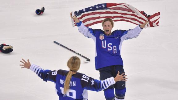 Team USA celebrates winning after a penalty shootout in the women's gold medal ice hockey match between Canada and the US.