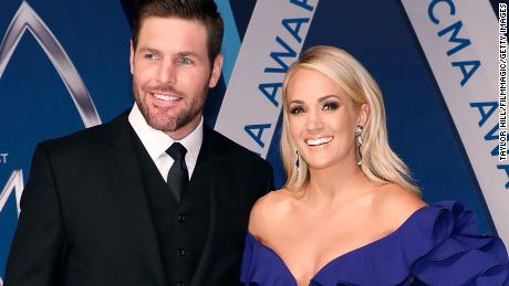 RESTRICTED NASHVILLE, TN - NOVEMBER 08:  Mike Fisher and Carrie Underwood attend the 51st annual CMA Awards at the Bridgestone Arena on November 8, 2017 in Nashville, Tennessee.  (Photo by Taylor Hill/FilmMagic)
