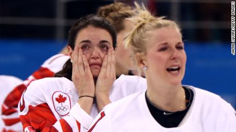 Players from Team Canada react after being defeated by Team United States 3-2 in the overtime penalty-shot shootout.