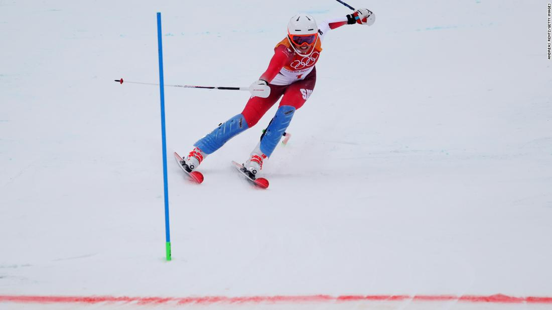 Switzerland's Michelle Gisin took gold, making an Olympic double for her family after elder sister Dominique won the downhill in Sochi four years ago. Her fellow Swiss Wendy Holdener won bronze.