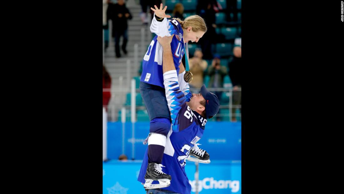 "American hockey player Kendall Coyne gets hoisted by her fiancé, Michael Schofield, as they savor the <a href=""https://www.cnn.com/2018/02/22/sport/olympics-ice-hockey-canada-us-intl/index.html"">US women's hockey team's 3-2 victory</a> over Canada to take the Olympic gold."