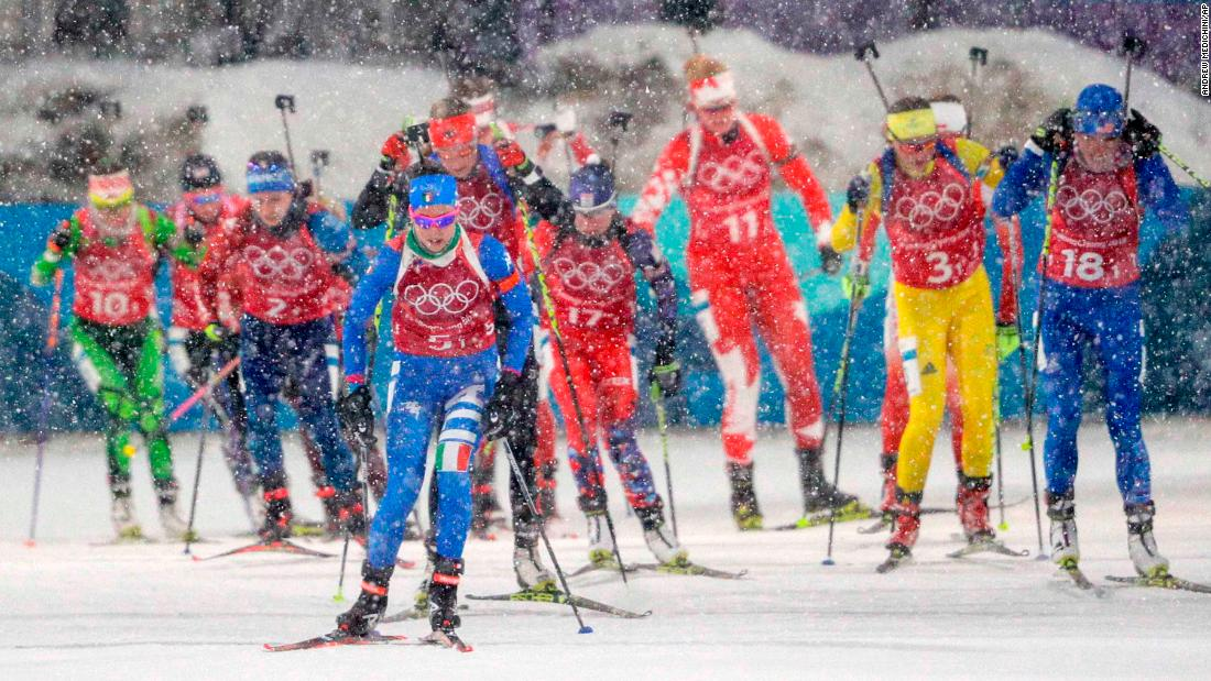 Italian biathlete Lisa Vittozzi leads a pack of skiers during the women's relay.
