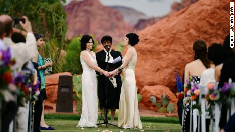 With the red rocks of southern Utah as a backdrop, Fatma Marouf, left, and Bryn Esplin vowed to spend their lives together and hoped to be parents.