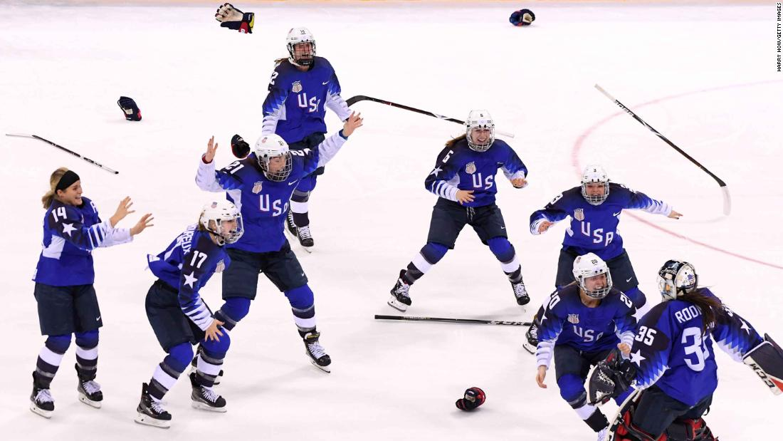 The US women's hockey team celebrates after defeating Canada in a shootout to win the gold. It's the first time the Americans have won the gold medal since 1998 when they also defeated Canada in the final.