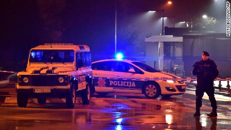 Police block off the area around the U.S. Embassy in Montenegro's capital Podgorica, Thursday, Feb. 22, 2018. Local media say that an unknown assailant hurled a hand grenade toward the embassy at around midnight local time (1100 GMT) and then killed himself with another explosive device. (AP Photo/Risto Bozovic)