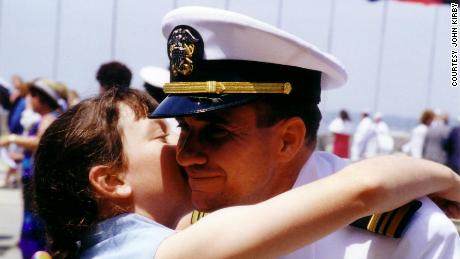 Meagan hugs her dad at his Naval War College graduation in Newport, RI, June 16, 2000.