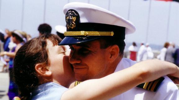 Meagan hugs her dad at his Naval War College graduation in Newport, RI, June 16, 2000.