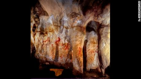 La Pasiega, section C. Cave wall with paintings. The scalariform (ladder shape) composed of red horizontal and vertical lines (centre left) dates to older than 64,000 years and was made by Neanderthals.