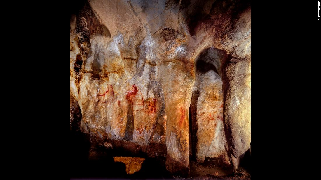 "This wall with paintings is in the La Pasiega Cave in Spain. The ladder shape of red horizontal and vertical lines is more than 64,000 years old<a href=""https://www.cnn.com/2018/02/22/health/neanderthal-art-symbols-cognition-study/index.html""> and was made by Neanderthals</a>."