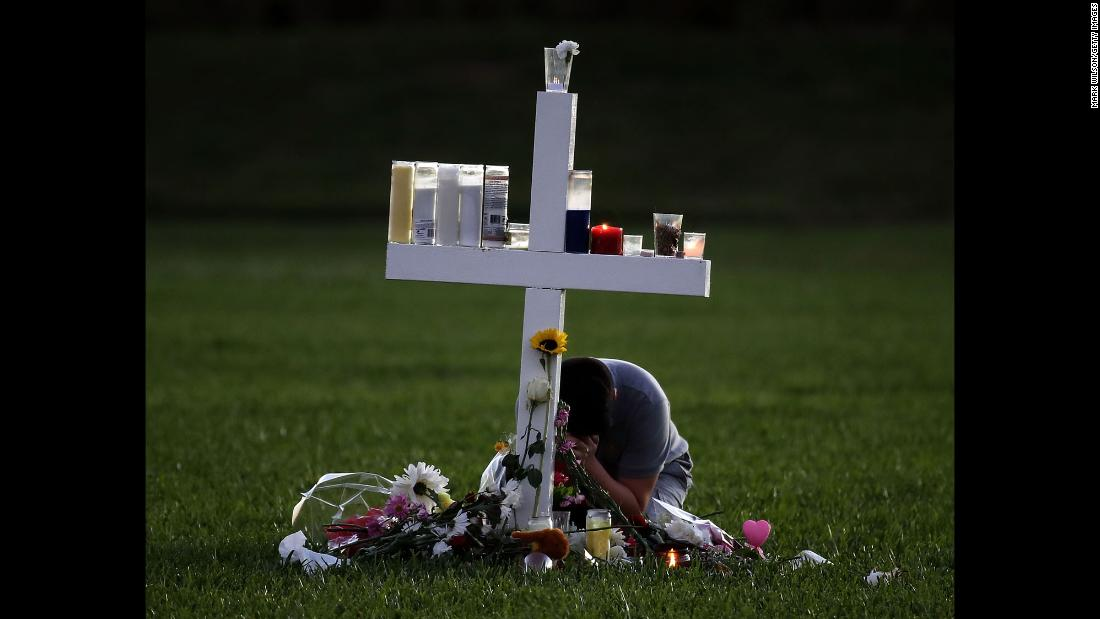 "A boy sits on Friday, February 16, at a memorial cross that <a href=""https://www.cnn.com/2018/02/15/us/florida-shooting-victims-school/index.html"" target=""_blank"">honors the victims</a> of the mass shooting at Marjory Stoneman Douglas High School in Parkland, Florida. The shooter, 19-year-old former student Nikolas Cruz,<a href=""https://www.cnn.com/2018/02/16/us/florida-school-shooting/index.html"" target=""_blank""> is willing to plead guilty</a>, according to his public defender."