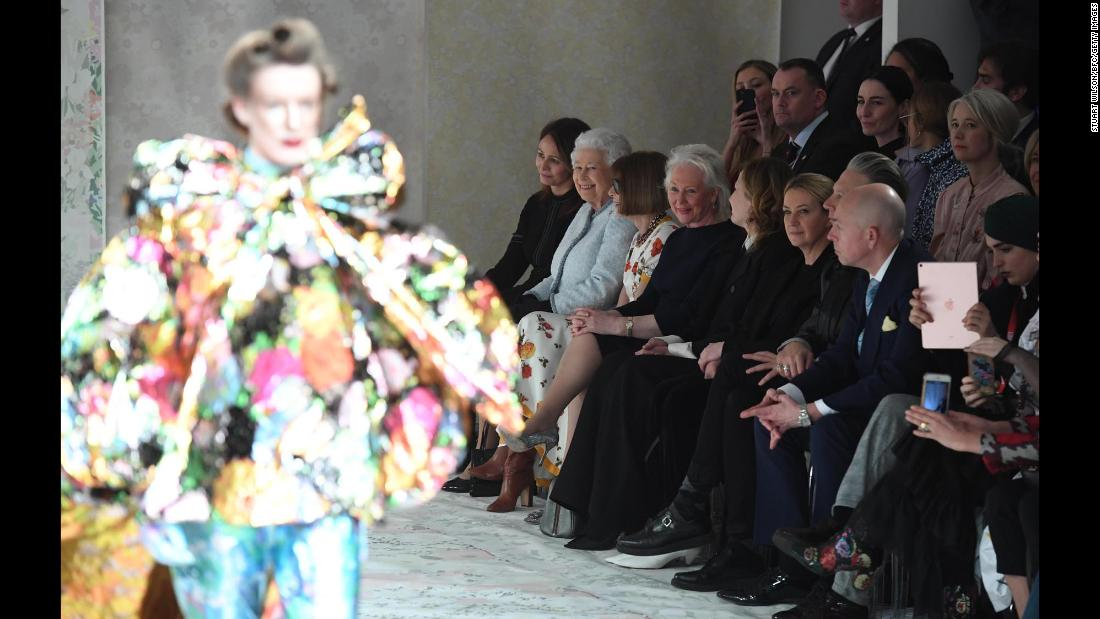 "Queen Elizabeth II, in light blue, takes in the Richard Quinn runway show beside Vogue editor Anna Wintour during London Fashion Week on Tuesday, February 20. <a href=""https://www.cnn.com/style/article/queen-elizabeth-london-fashion-week/index.html"" target=""_blank"">The Queen later presented</a> the designer with the inaugural Queen Elizabeth II Award for British Design."