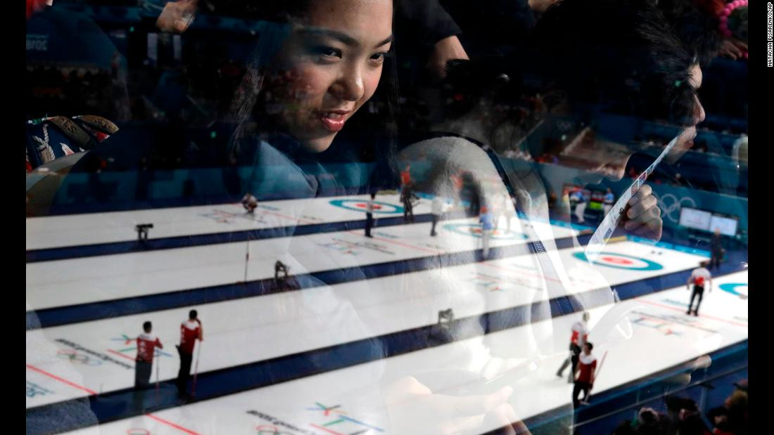 "A woman is seen through glass as she watches the men's curling matches at the 2018 Winter Olympics on <a href=""http://www.cnn.com/2018/02/18/sport/gallery/winter-olympics-0218/index.html"" target=""_blank"">Sunday, February 18</a>."