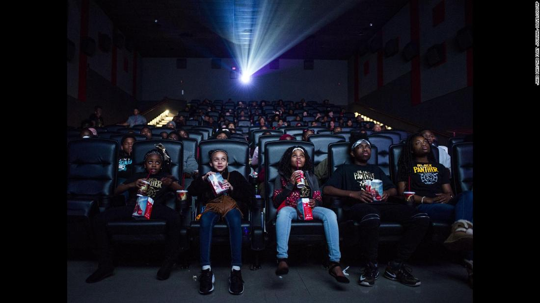 "Mari Copeny, third from left, watches a <a href=""https://www.cnn.com/2018/02/01/entertainment/octavia-spencer-black-panther/index.html"" target=""_blank"">free screening</a> of the film ""Black Panther"" with more than 150 children, after she raised $16,000 to provide free tickets in an entire theater on Monday, February 19, in Flint, Michigan. <a href=""https://www.cnn.com/2018/02/16/africa/black-panther-behind-the-scenes-marvel/index.html"" target=""_blank"">A journey into Wakanda</a>"