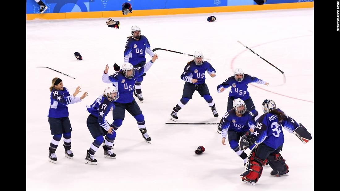 "Team USA celebrates after <a href=""http://www.cnn.com/interactive/2018/02/sport/winter-olympics-cnnphotos/index.html"" target=""_blank"">winning a shootout</a> in the gold-medal hockey game against Canada on Thursday, February 22. It's the first time the American women have won the gold medal since 1998, when they also defeated Canada in the final."