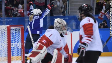 USA's Monique Lamoureux-Morando (left) celebrates scoring against Canada.