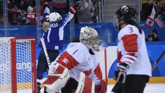 USA's Monique Lamoureux-Morando (left) celebrates scoring against Canada.