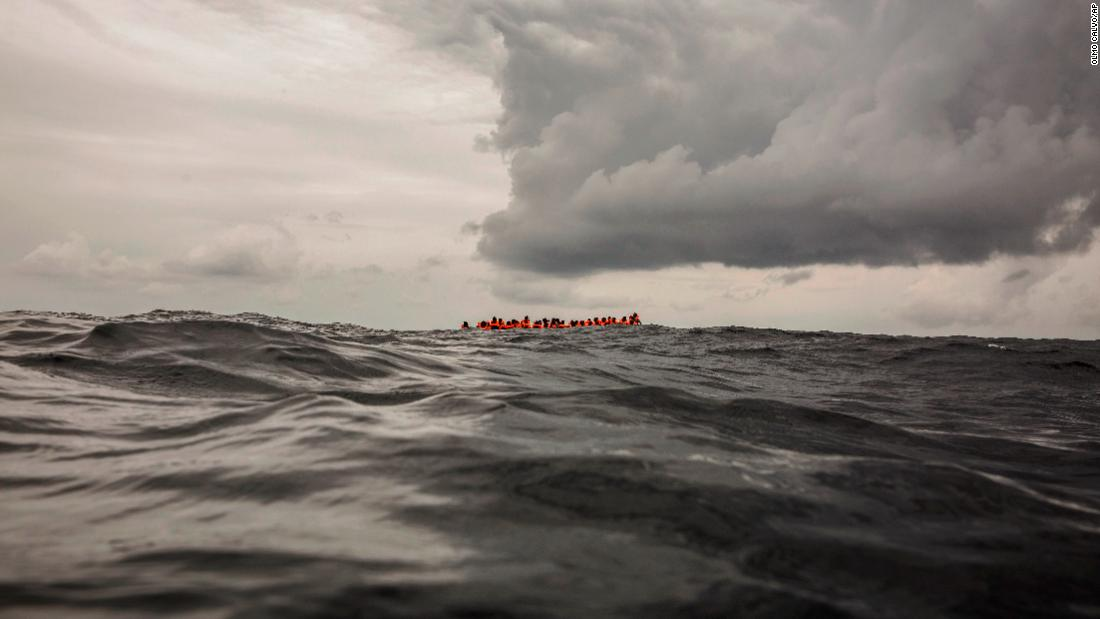 "Refugees and migrants wait an overcrowded rubber boat to be rescued by aid workers from the Spanish NGO Proactiva Open Arms on Sunday, February 18. They had left Libya and were trying to reach European soil. <a href=""https://www.cnn.com/2018/02/20/world/child-migrants-libya/index.html"" target=""_blank"">A child migrant's story</a>"