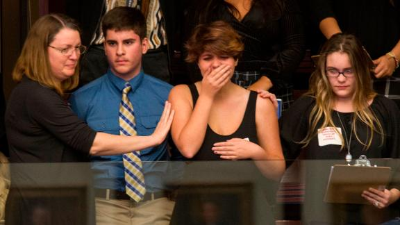 Sheryl Acquarola, a 16 year-old junior from Marjory Stoneman Douglas High School is overcome with emotion in the east gallery of the House of Representatives after the representatives voted not to hear the bill banning assault rifles and large capacity magazines at the Florida Capital in Tallahassee, Fla., Feb 20, 2018. Acquarola was one of the survivors of the Marjory Stoneman Douglas High School shooting that left 17 dead, who were in Tallahassee channeling their anger and sadness into action. (AP Photo/Mark Wallheiser)
