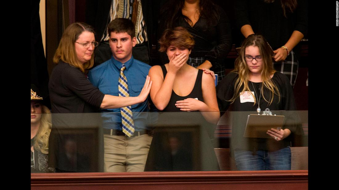 "Sheryl Acquarola, a 16 year-old junior from Marjory Stoneman Douglas High School, reacts in the gallery of the House of Representatives in Tallahassee, Florida, after lawmakers <a href=""https://www.cnn.com/2018/02/20/us/florida-legislature-weapons-ban/index.html"" target=""_blank"">voted not to hear the bill</a> banning assault rifles and large capacity magazines on Tuesday, February 20. Students and teachers who survived the shooting at Stoneman Douglas <a href=""https://www.cnn.com/2018/02/21/us/florida-school-shooting/index.html"" target=""_blank"">traveled to Florida's capitol</a> to demand action from state lawmakers."