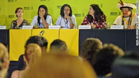 "Jurema Werneck (C), head of human rights watchdog Amnesty International in Brazil, speaks during a press conference in Rio de Janeiro on February 21, 2018. Amnesty International is concerned about the Brazilian government's plans for military intervention to police Rio's poor favela neighborhoods. ""The intervention in Rio is an inadequate and extreme measure that is worrying because it puts the population's human rights at risk,"" said Jurema Werneck, head of the rights group in Brazil.  / AFP PHOTO / CARL DE SOUZA        (Photo credit should read CARL DE SOUZA/AFP/Getty Images)"