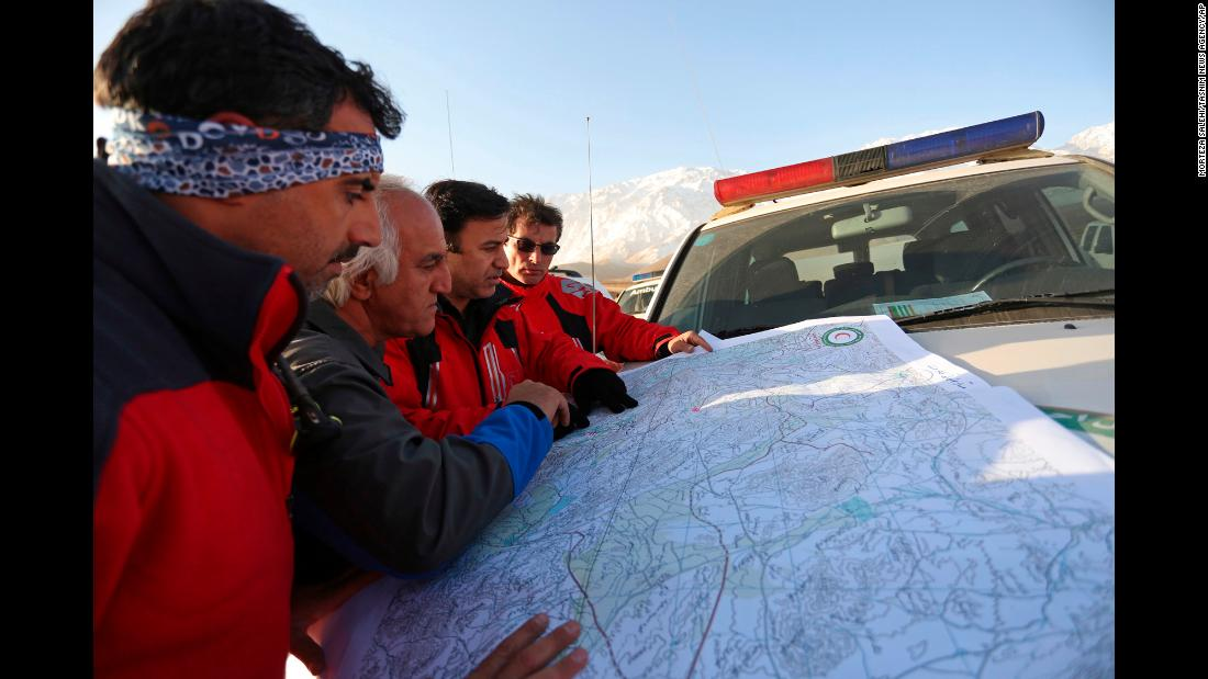 "In this February 20 photo, a search and rescue team studies a map of the area where a <a href=""https://www.cnn.com/2018/02/18/middleeast/iran-plane-crash/index.html"" target=""_blank"">plane crashed</a> on February 18 on Mount Dena, in southern Iran. All <a href=""https://www.cnn.com/2018/02/19/middleeast/iran-plane-crash-site-found-intl/index.html"" target=""_blank"">65 people on board</a> the passenger plane are presumed dead, the airline said."