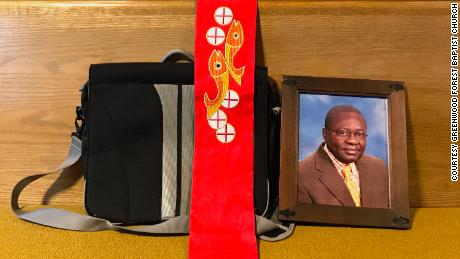 A photo of Gilles Bikindou sits on a pew at Greenwood Forest Baptist Church, where he prayed regularly for years before immigration authorities arrested him in January.